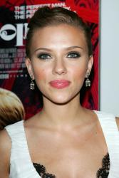 """NEW YORK - JULY 26: Actress Scarlett Johansson attends the Focus Features and Loreal premiere of """"Scoop"""" at the Museum of Modern Art July 26, 2006 in New York City. (Photo by Evan Agostini/Getty Images)"""