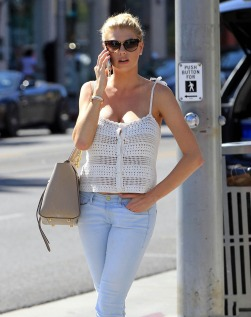 51810805 Model Charlotte McKinney chats on her phone while out and about in Beverly Hills, California on July 28, 2015. Charlotte was recently called 'the next Kate Upton' after she starred in a Carl's Jr. ad in January. FameFlynet, Inc - Beverly Hills, CA, USA - +1 (818) 307-4813